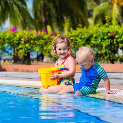 Children splashing in pool.
