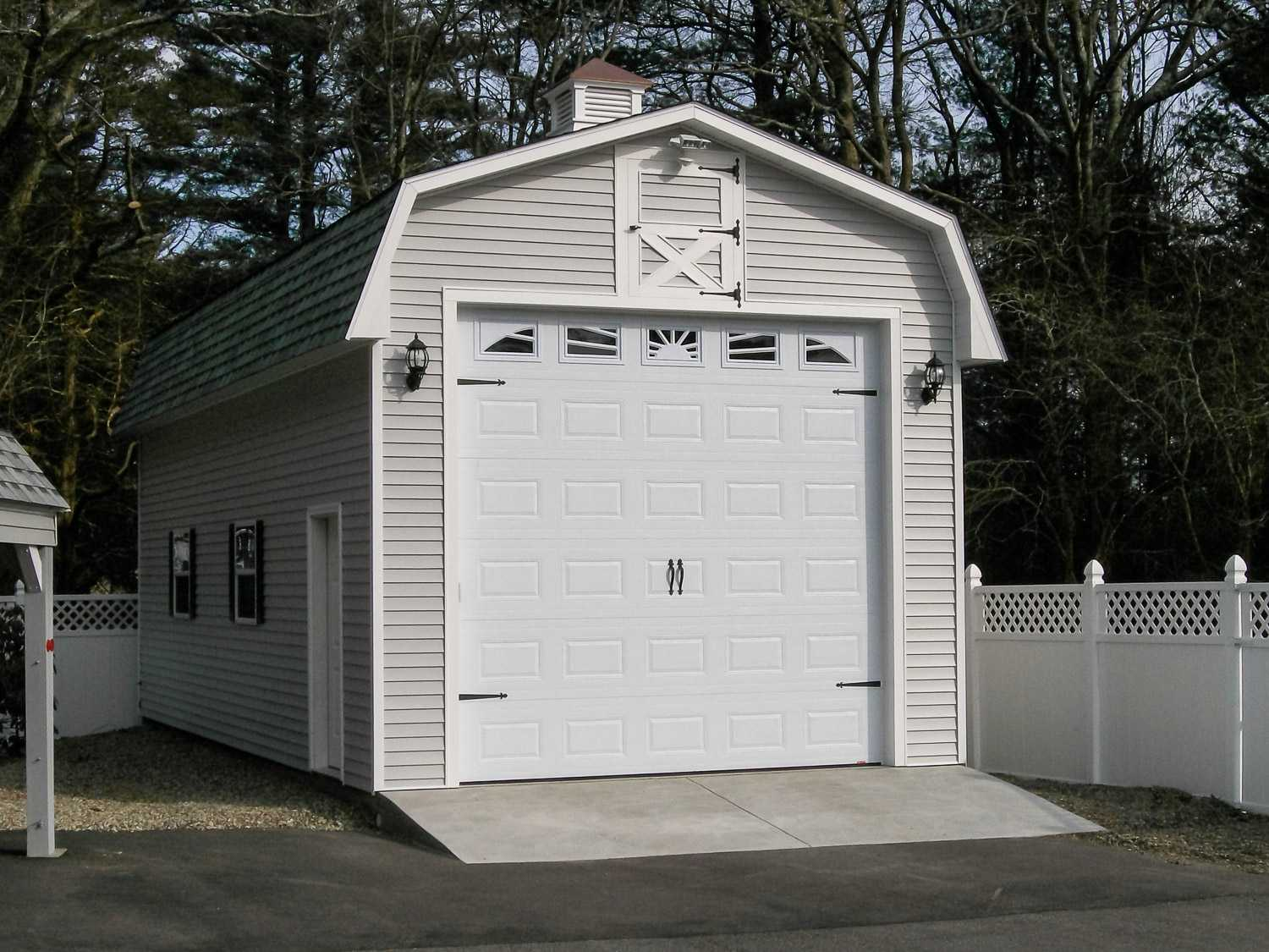 This Personalized Detached Garage Features Gambrel Shingled Roof Oversized Door Vinyl Siding