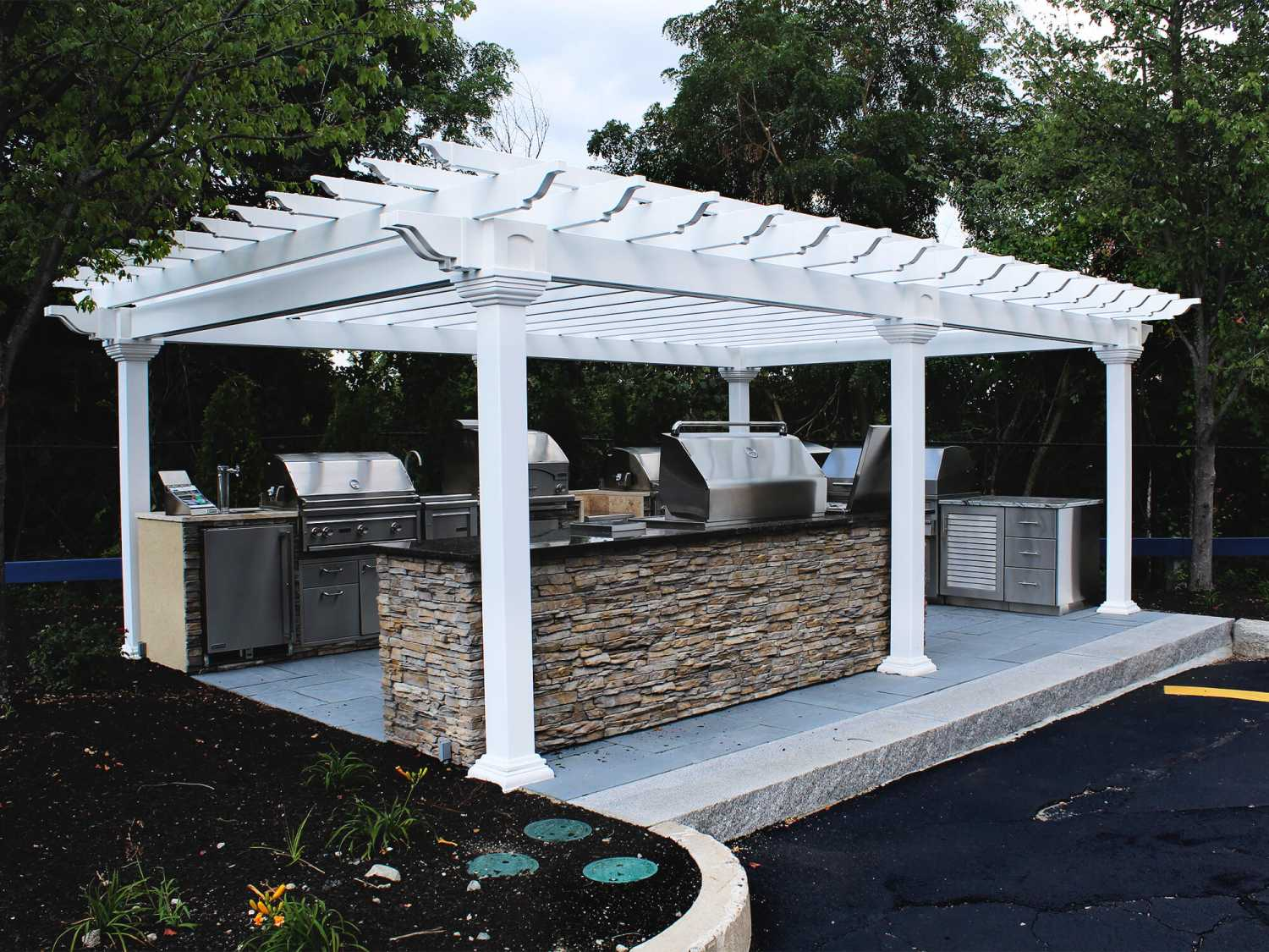 This White Vinyl Pergola Completes Backyard Kitchen Area And Is Built With Durable Materials Made To Last A Lifetime