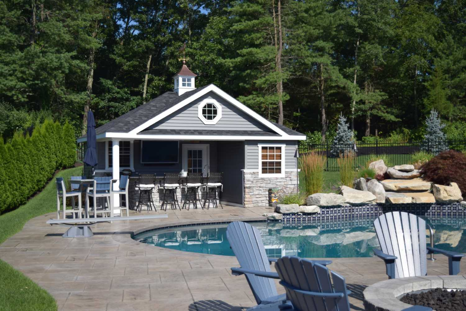 This Beautiful Poolhouse Includes A Bathroom Changing Area Plus Storage Room And Also There Is Full Bar