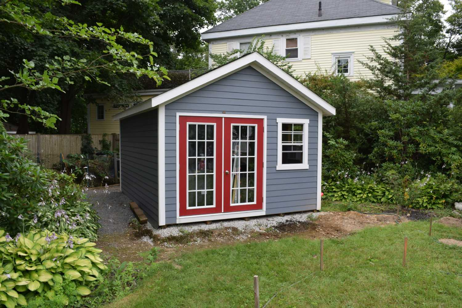 This Backyard Shed Features Double Full Glass Doors And Vinyl Siding  Exterior And Is On A Crushed Rock Foundation.
