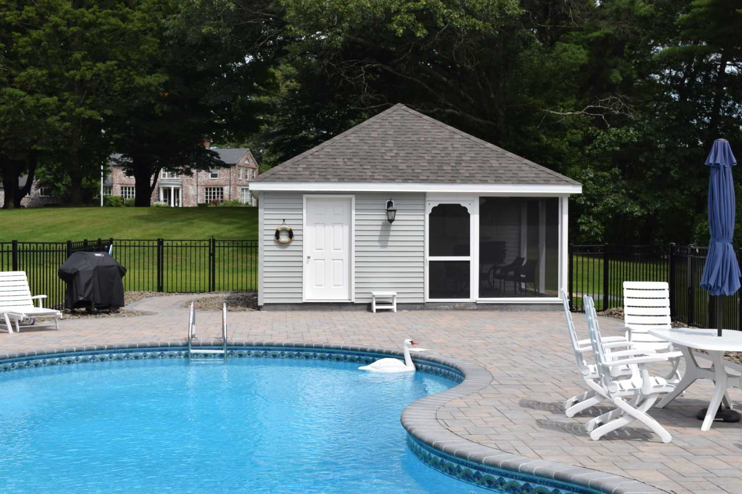 Poolhouse With Storage Area And A Full Screened In Sitting Area With  Plumbing And Electric.