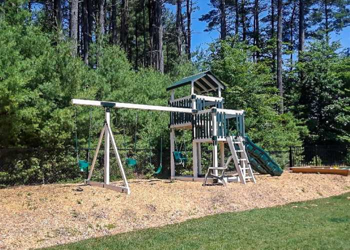 Sierra Maintenance Free Vinyl Playset with Swings, Slides & Activity Centers
