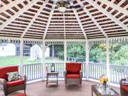 Beautiful gazebo with exposed rafters, electrical package, and screens.