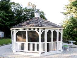 Gazebo is very large octogan shape, wit double doors, screens and shingled roof, lots of room for relaxing without worrying about insects.