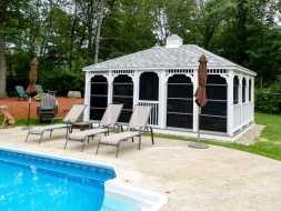 This rectangle gazebo is large with removable screens, hip roof design, and a cupola, makes a beautiful addition to the poolside.