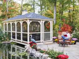Gazebo featuring removable screens, and white vinyl construction, and gray shingled roof.