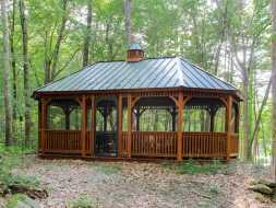 Large gazebo octagon oval shape with metal roof, stained cedar wood, make this gazebo stand out anywhere.