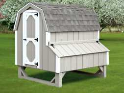 Chicken Coop is designed to look like a barn, with gambrel roof and nesting boxes on the side.