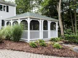 Gazebo with removable screens, beautiful trim, and its all vinyl construction, for years of durability.
