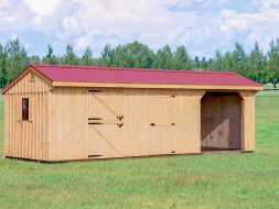 Horse barn featuring vertical cedar siding, red metal roof, with 2 stalls, and open storage/parking area.