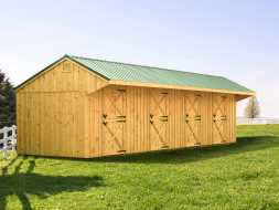 Horse Barn featuring a metal salt box roof design, cedar vertical siding, and four stalls.