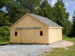 Horse Barn with sliding double door, wood exterior, gable roof, and penty of room.