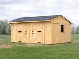 This horse barn features 2 stalls, cedar vertical siding, and shingle roof.