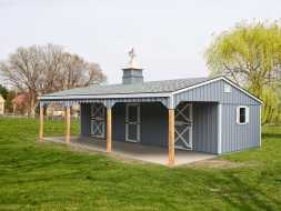 This 3 stall horse barn features painted wood siding, gable roof, and a open porch area.