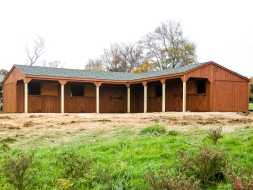 Horse Barn has lots of room, cedar siding exterior, shingled gable roof and a custom (L) shape design.