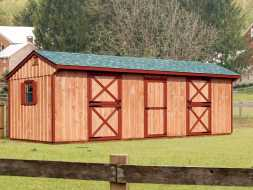 This horse barn features tack room and 2 stalls, and windows with shutters.