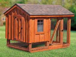 Chicken Coop is built with stained cedar siding and features a open air run area.
