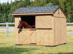 This small 1 horse barn features dutch style door, shingle roof, and cedar exterior.