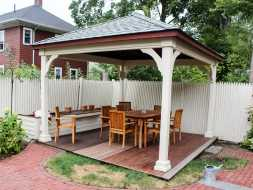 Pavilion featuring vinyl columns stained wood interior, and gray shingled roof.