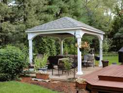 This white vinyl pavilion is built on customer existing patio deck.