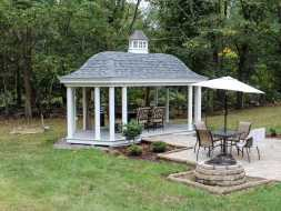 Pavilion featuring custom roof, with cupola accent, and round vinyl columns.