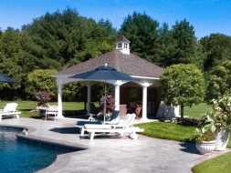 Pavilion with wall on the back for privacy and features cupola accent and vinyl columns.