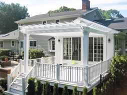 White Vinyl Pergola built on patio great addition to the backyard.