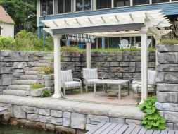 This backyard pergola is complete vinyl construction with an ez shade.