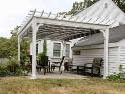This patio pergola is built with white vinyl, and features an ez shade.