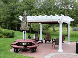 This small patio pergola is beautiful accent to the backyard, and the vinyl construction will last for many years.
