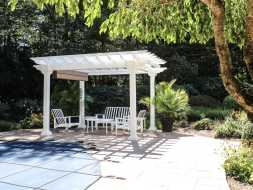 Poolside pergola features white vinyl and an ez shade, great location.