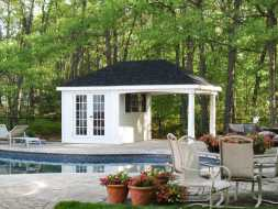Poolhouse with open sitting area and changing room, with double 15 lite doors.