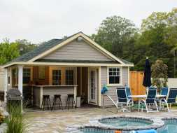 Pool House features outdoor bar area, and changing room with a storage area, plus lots of windows.