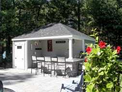 Personalized pool house with outside bar, storage room, and electrical package.