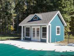 Pool House featuring vinyl siding exterior, white trim, oversized windows, A-frame dormer with window, and shingled gable roof.