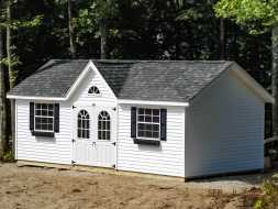 This personalized shed features custom windows and doors, vinyl siding & trim, and victorian style dormer.