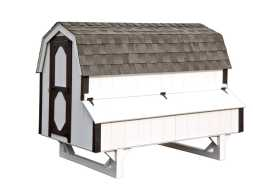 Chicken Coop is built to look like a small barn has nest boxes that are accessed from the outside, and large door on side for cleaning access.