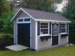 This custom storage shed has vinyl siding exterior shingle roof, and personalized doors & windows.
