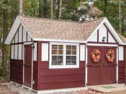 This personalized storage shed featuring unique tudor style with electrical package.