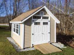 This custom shed has ramp for lawn equipment, double door on the end and custom window selection.