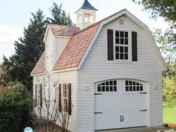 This storage shed is big and has plenty of room for all your stuff, plus it looks good with gambrel roof and lots of windows and features a roll up garage door.