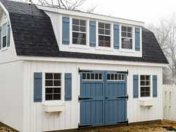 Shed is personalized with shed roof dormer, lots of windows and custom color options.