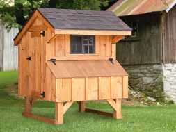 Chicken Coop is constructed with cedar board and batten siding, small sliding window offers ventilation.