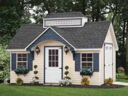 Storage shed with pagoda roof and windows with boxes and shutters and features an electrical package.