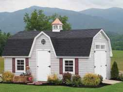 This shed looks like a small barn with it gambrel roof and cupola, and features vinyl siding exterior and a shingled roof plus plenty of doors.