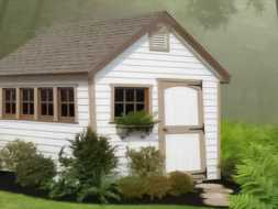 This custom small shed built featuring vinyl siding and shingled roof and has a specific design.