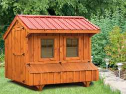 Chicken Coop featuring red metal roof with nest boxes and windows & doors.
