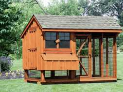 Chicken Coop has a large open air run area with nesting boxes and large access door.