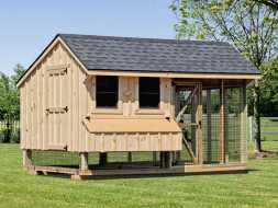This large chicken house i constructed with board and batten siding and shingled roof plus has a large screened run area.